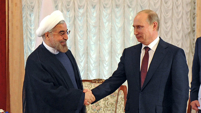 Russia's President Putin shakes hands with his Iranian counterpart Rouhani during a meeting at the SCO summit in Bishkek